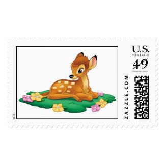 Bambi sitting on the grass postage